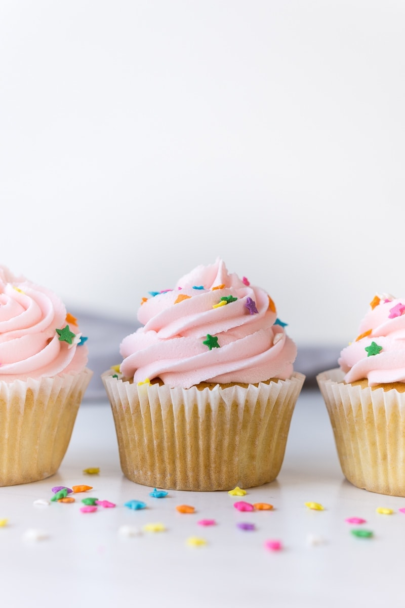 Vanilla Cupcakes with a swirl of vanilla buttercream frosting and sprinkles
