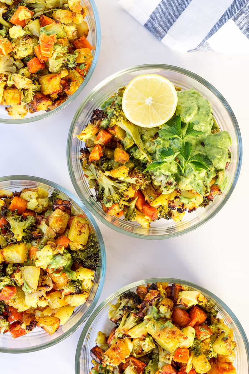 meal prep of roasted veggie bowls with green goddess sauce