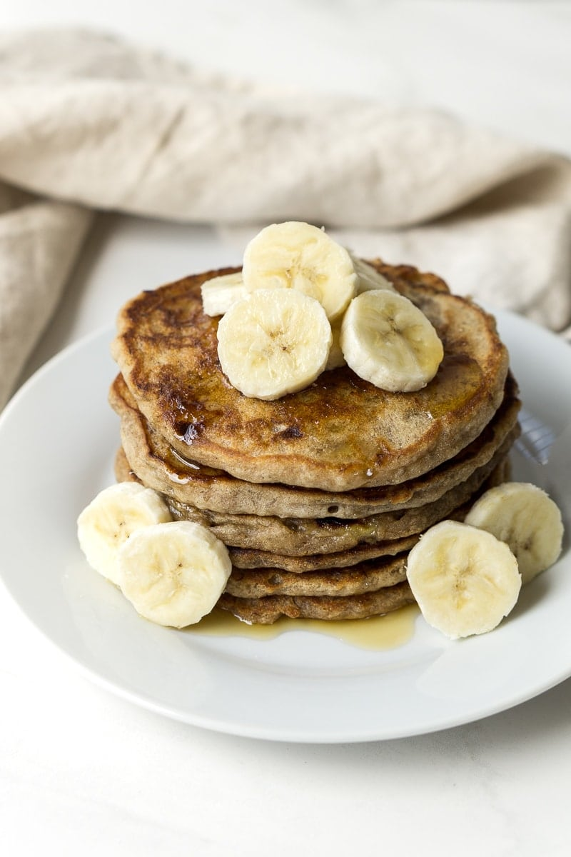 vegan banana pancakes with banana and maple syrup
