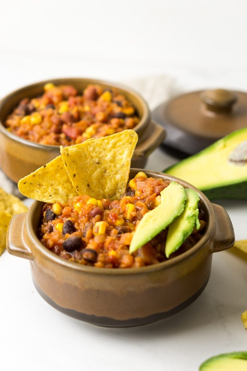 Vegan Slow Cooker Lentil Chilli with corn chips and avocado