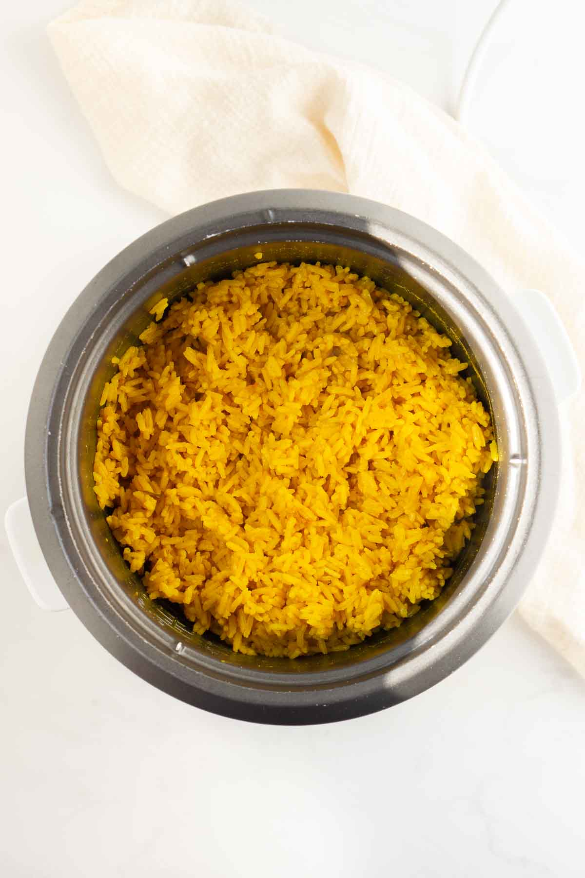 cooked turmeric rice in the rice cooker